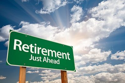 "Highway road sign that says ""Retirement Just Ahead"""